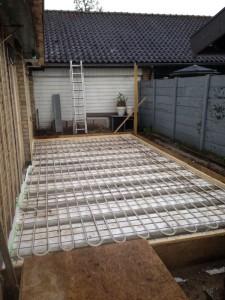 Vloerverwarming aanleggen voor de vloer van deze aanbouw
